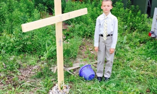 This little boy's turtle died, so he put on a tie and had a funeral