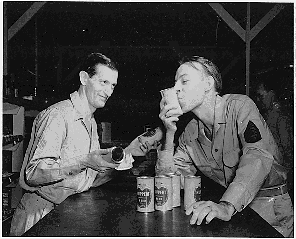 Pictures of Americans drinking beer. One man is kissing the beer can.