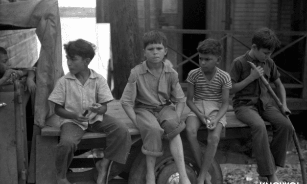 Boys eating sugarcane in a small fishing village of Puerto Real