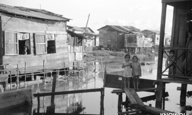 "Children near their home in the slum area known as ""El Fangitto"""