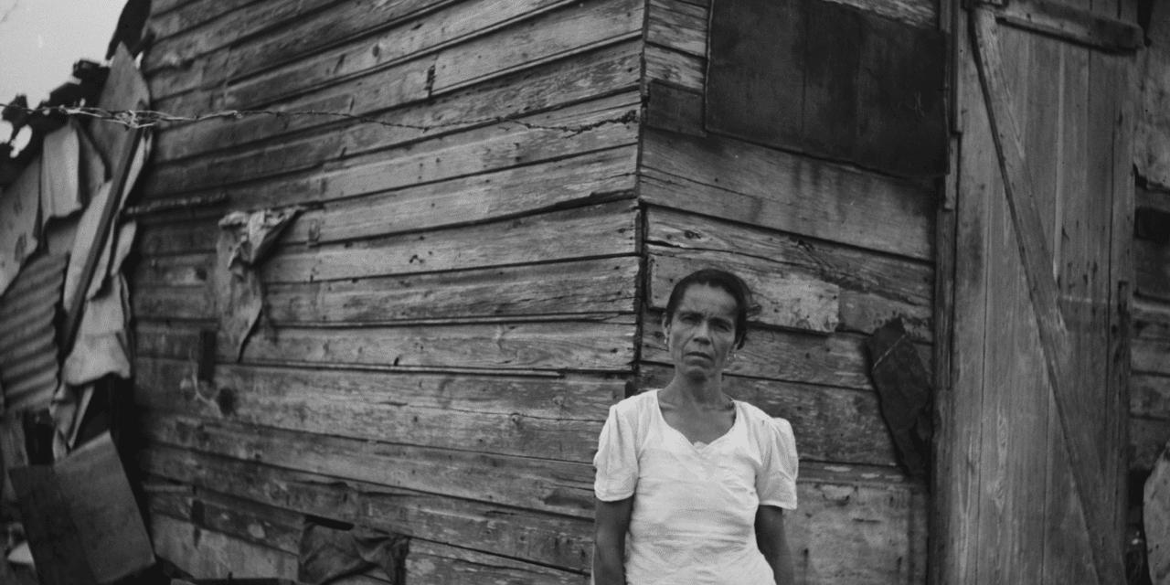 Woman in front of her house in Santurce, San Juan, Puerto Rico