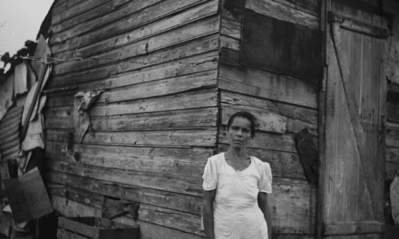 Woman in front of her house in Santurce, San Juan, Puerto Rico