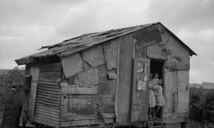 A family in the doorway of their home in Santurce, Puerto Rico