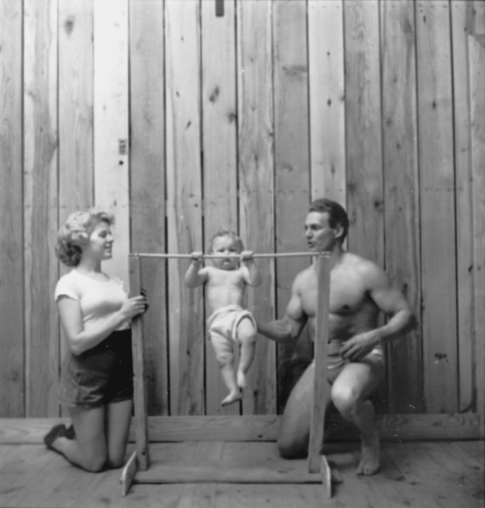 A photograph by Stanley Kubrick showing Bodybuilder Gene Jantzen with wife Pat, and eleven-month-old son Kent