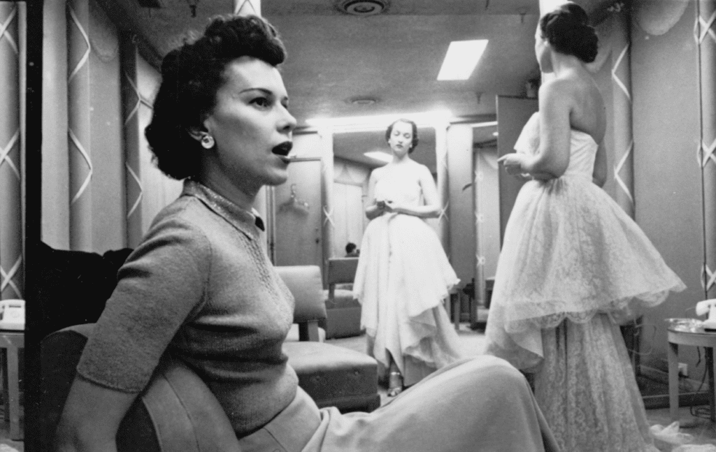 A photograph by Stanley Kubrick showing women trying on dresses in Chicago