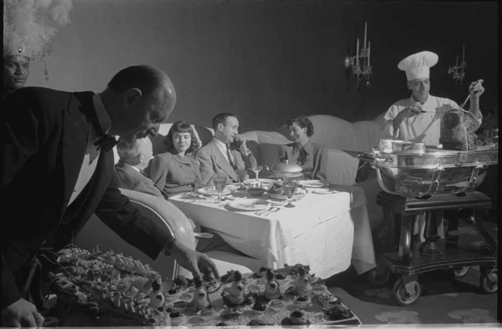 A photograph by Stanley Kubrick showing a family eating dinner in Chicago