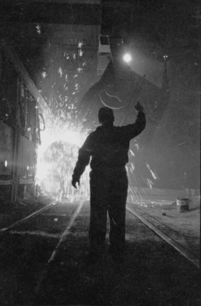 A picture by photographer Stanley Kubrick showing a worker in a steel meel