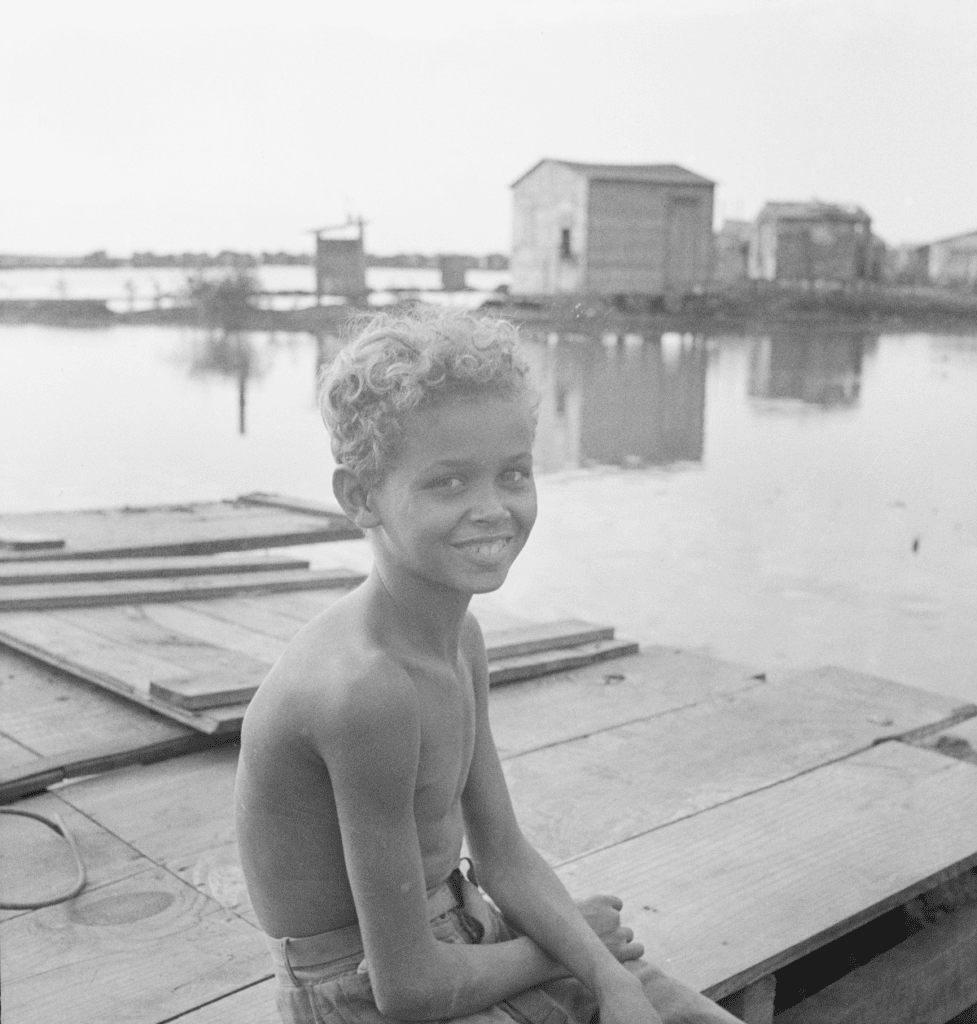 A boy sitting in the San Juan Slum of El Fangitto in 1941
